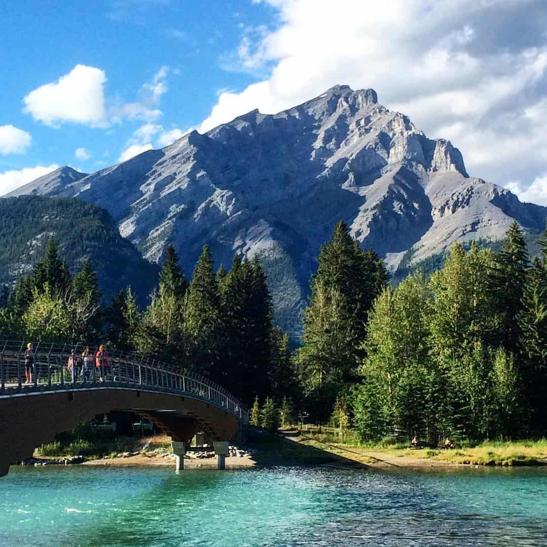 The calm after the storm- can you believe it was raining 30 mins before this shot was taken?! I love how the rain freshens everything up. Perfect running temps! #guidemebanff #mybanff #explorealberta #beautiful #neverstopexploring #bowriverruns #bowriver #mountains #cascade #bridges #beautiful