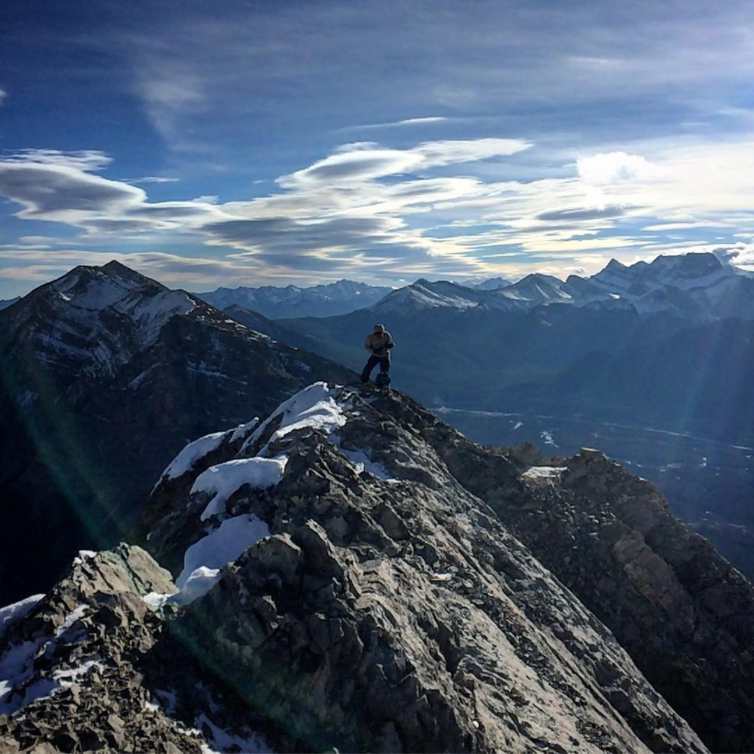November 13th: Lady Macdonald, Canmore. This time last year we were enjoying a 40cm day at Lake Louise! @mrmiyagi267 getting ready to take some stunning photos on the knife ridge on Lady Mac. Wanted to hike this one for a loooong time so it's great to check it off the list! #guidemebanff #mybanff #ladymac #canmore #neverstopexploring #novemberhike #whatsnow #skiingsoon #mountains #summitsunday #scrambling #getoutside #getoutdoors #gethigher
