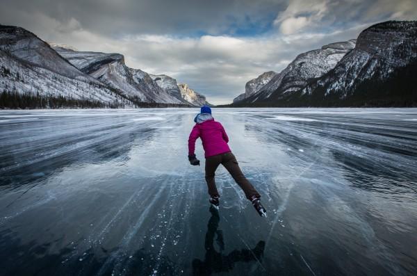 Ice Skating on Lake Minnewanka // photo credit Paul Zizka Photography.